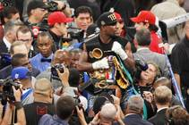 Floyd Mayweather holds his belts after defeating Canelo Alvarez during their super welterweight title fight Saturday, Sept. 14, 2013 at the MGM Grand Garden Arena. ...