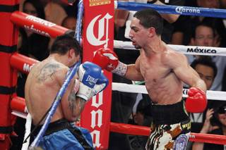 Danny Garcia sends Lucas Matthysses into the ropes during their fight Saturday, Sept. 14, 2013 at the MGM Grand Garden Arena.