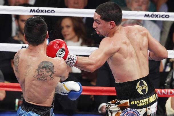 Danny Garcia hits Lucas Matthysses with a left during their fight Saturday, Sept. 14, 2013 at the MGM Grand Garden Arena.
