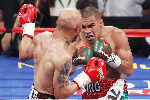 Carlos Molina closes in on Ishe Smith during their fight Saturday, Sept. 14, 2013 at the MGM Grand Garden Arena.