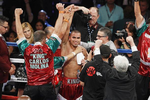 Carlos Molina celebrates his win over Ishe Smith during their fight Saturday, Sept. 14, 2013 at the MGM Grand Garden Arena.