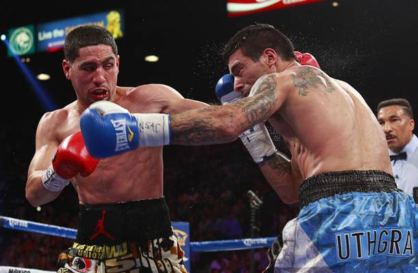 WBC/WBA junior welterweight champion Danny Garcia , left, connects on Lucas Matthysse of Argentina during their title fight at the MGM Grand Garden Arena Saturday, Sept. 14, 2013.