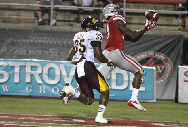 UNLV junior wide receiver Devante Davis catches a 42-yard touchdown to tie the game 21-21 against Central Michigan at Sam Boyd Stadium Saturday, Sept. 14, 2013.
