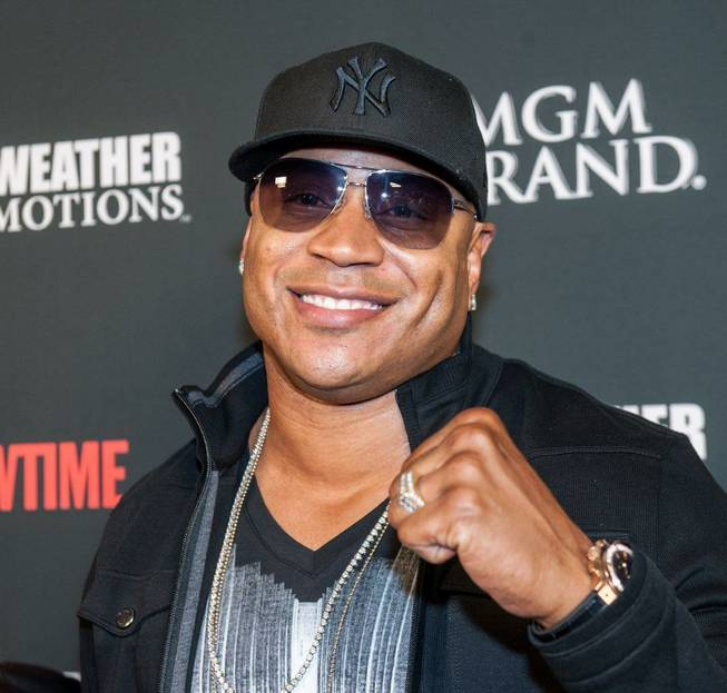 LL Cool J arrives at the pre-fight red carpet for ...