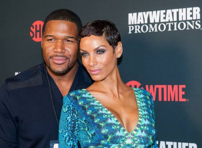 Michael Strahan and his fiancee Nicole Murphy arrive at the ...