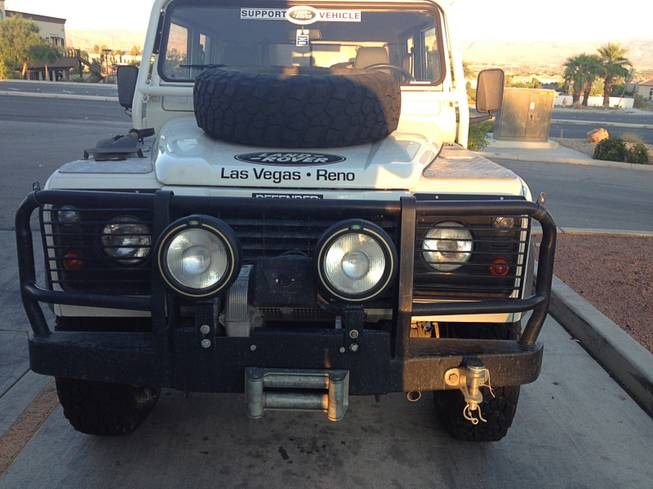 The 1997 Land Rover Defender is a four-cylinder turbo diesel with a five-speed manual transmission. It's full-time four-wheel drive with an air-locking rear differential. And, no, it's not for sale - it's on loan from Land Rover Las Vegas.