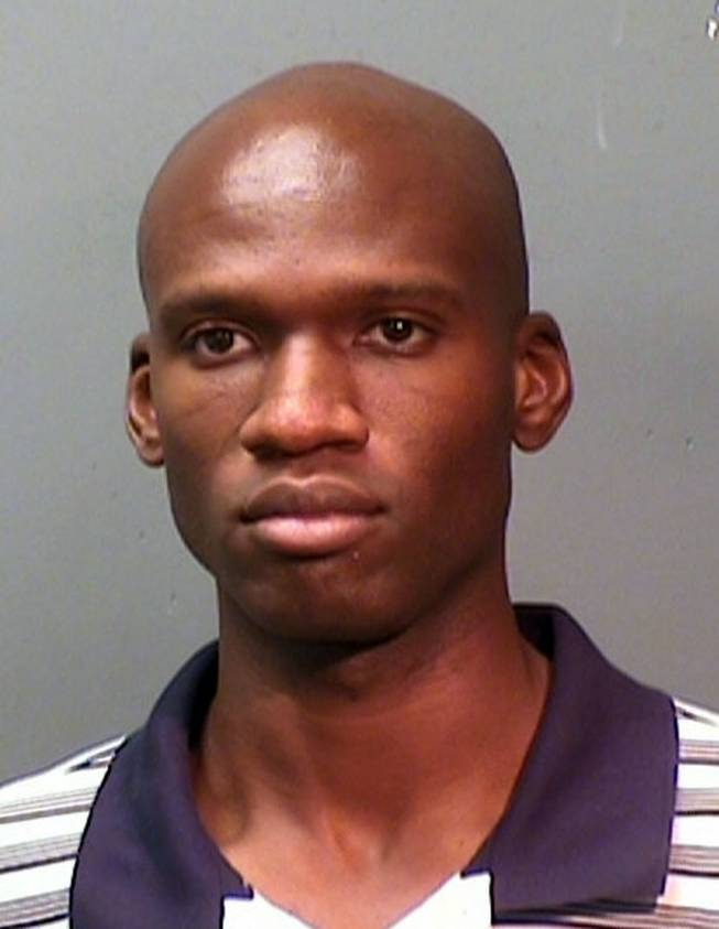 This undated photo provided by the Fort Worth Police Department shows a booking mug of Aaron Alexis, arrested in September, 2010, on suspicion of discharging a firearm in the city limits. Alexis is suspected to be the shooter at the Washington D,C. Navy Yard Monday, September 16, 2013.
