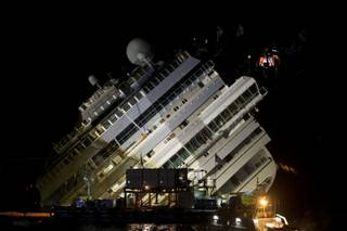 The Costa Concordia ship lies on its side on the Tuscan Island of Giglio, Italy, Monday, Sept. 16, 2013.