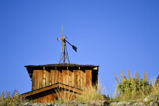 A weather vane stands atop a building in Belmont, Nev., on Sept. 17, 2013.