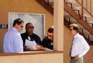 Clark County School Superintendent Pat Skorkowsky, left, attendance officer Javier Morales, senior attendance officer Pam Gunter and Rancho High School principal James Kuzma look for a Rancho High School student at an apartment complex Wednesday, September 18, 2013. They later found out at the apartment office that the family had moved.