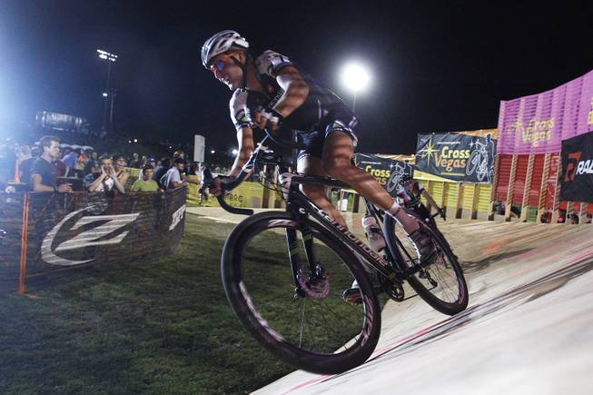 Third-place finisher Geoff Kabush leads second-place finisher Jeremy Powers over a velodrome-like section during the Cross Vegas cyclocross race Wednesday, Sept. 18, 2013. The race was won by two-time and current world champion Sven Nys of Belgium.