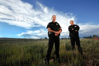 Albany County Sheriff David O'Malley, left, and Under Sheriff Rob DeBree in Laramie, Wyoming, near where Matthew Sheppard was beaten and left hanging on a fence in an anti-gay crime 15 years ago. Sheppard died of his injuries soon after the October 12, 1998, attack.