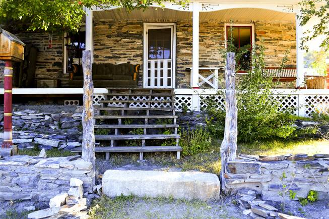 "The steps of the Belmont Inn & Saloon, which was once the home of town ""guardian"" Rose Walter, are shown here on Sept. 18, 2013. The building was also a stagecoach stop in the 1880s. Below the steps is a ""stagecoach stone,"" which is where passengers would step on and off."