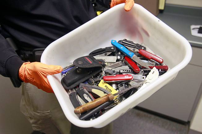 Clark County Deputy Marshal Curt Taylor holds a tray of knives confiscated in September at the Regional Justice Center Thursday, September 19, 2013.