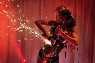 "Dancer Moorea Wolf performs during ""X Rocks"" at the Rio on Thursday, Sept. 19, 2013."