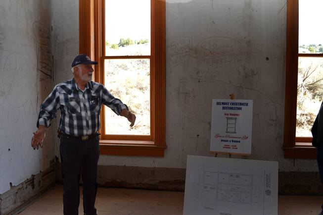 Retired schoolteacher Terry Terras gives a tour of the historic Belmont Courthouse, which is being revamped.