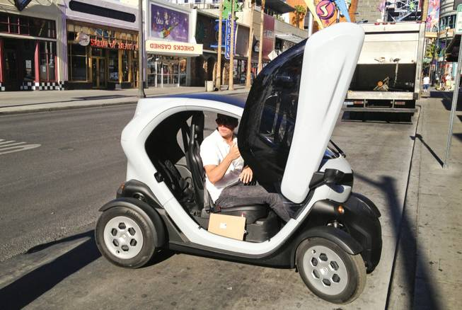 The Twizy, a Renault-made all-electric vehicle, is being tested by Downtown Project to see if it might fit with the Project's planned multi-model transportation system. Andy Chatham demonstrates the vehicle, Thursday, Sept. 19, 2013.