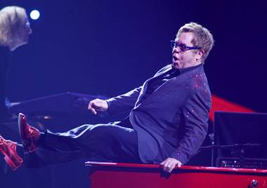 Elton John performs during the iHeartRadio Music Festival at the MGM Grand Garden Arena Friday, Sept. 20, 2013.