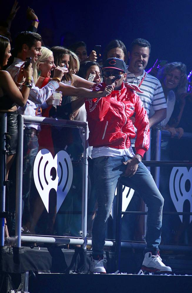 Chris Brown performs during the iHeartRadio Music Festival at the MGM Grand Garden Arena Friday, Sept. 20, 2013.