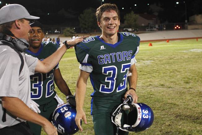 Green Valley kicker Conor Perkins is congratulated after their win over Palo Verde Friday, Sept. 20, 2013. Green Valley won the game in overtime 42-41.