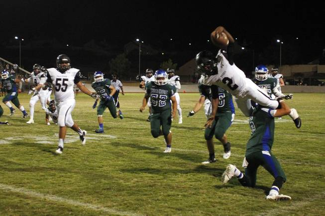 Palo Verde running back Hykeem Massey is upended by Green Valley cornerback Jacob Rivero during their game Friday, Sept. 20, 2013. Green Valley won the game in overtime 42-41.