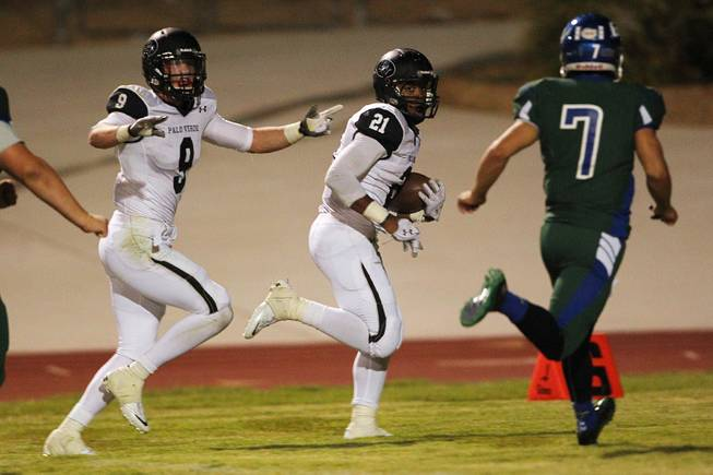 Palo Verde running back Jaren Campbell heads to the end zone during their game against Green Valley Friday, Sept. 20, 2013. Green Valley won the game in overtime 42-41.