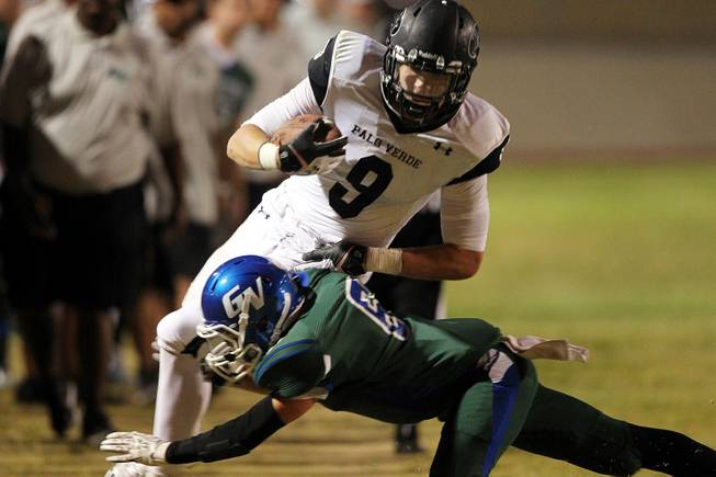 Green Valley cornerback Jacob Rivero takes down Palo Verde tight end Jake Ortale during their game Friday, Sept. 20, 2013. Green Valley won the game in overtime 42-41.