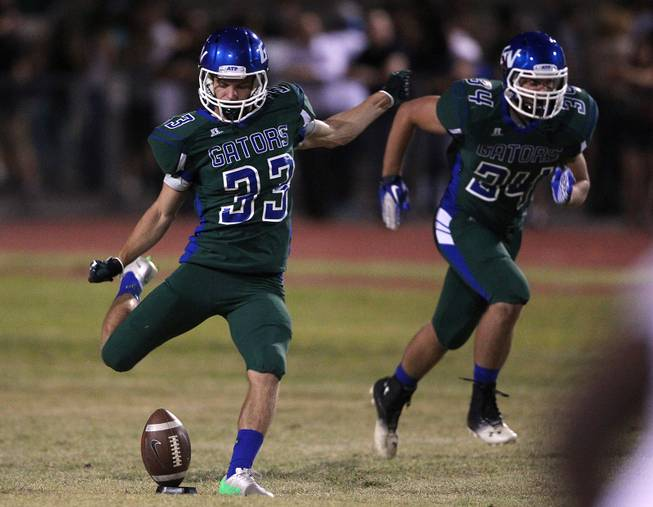 Green Valley kicker Conor Perkins sends off a kick to Palo Verde during their game Friday, Sept. 20, 2013. Green Valley won the game in overtime 42-41.