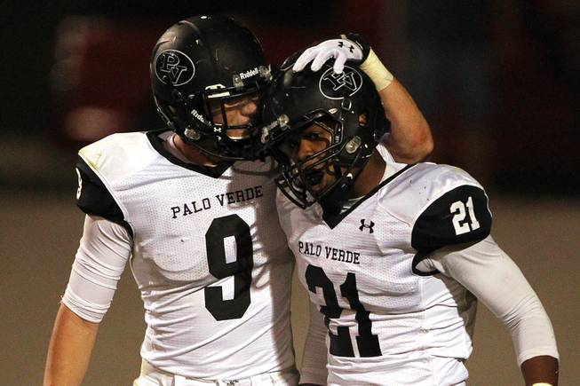Palo Verde running back Jaren Campbell is congratulated by teammate Jake Ortale after scoring a touchdown against Green Valley during their game Friday, Sept. 20, 2013. Green Valley won the game in overtime 42-41.