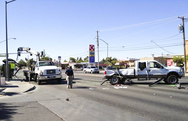 The scene of a two-vehicle crash at Bonanza Road and Lamb Boulevard in which, Metro Police said, a pickup truck careened into a bus stop. Three children at the bus stop were injured, police said.