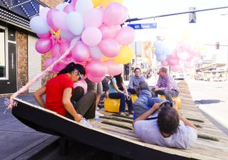 UNLV architecture students and faculty relax on their wood pallet-and-grass parabolic curve on Fremont Street directly south of the El Cortez, Friday, Sept. 20, 2013. They are participating in the day-long Parks,