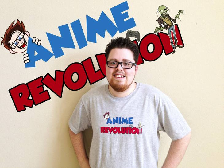 "Jake Anderson poses in front of his store's, ""Anime Revolution,"" sign."