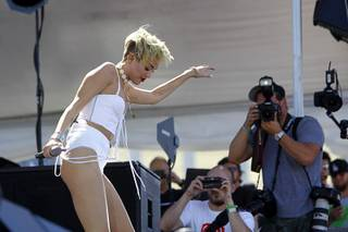 Miley Cyrus dances in the Village across from the Luxor during the 2013 iHeartRadio Music Festival on Saturday, Sept. 21, 2013.
