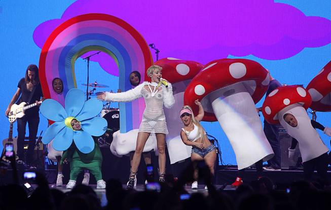 Miley Cyrus performs during the 2013 iHeartRadio Music Festival at MGM Grand Garden Arena on Saturday, Sept. 21, 2013.