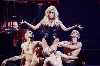 Ke$ha performs with dancers during the iHeartRadio Music Festival in the MGM Grand Garden Arena Saturday, Sept. 21, 2013.