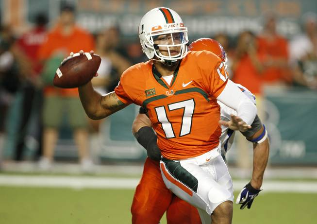 Miami quarterback Stephen Morris passes the football during the first half of an NCAA college football game against Savannah State, Saturday, Sept. 21, 2013, in Miami Gardens, Fla.