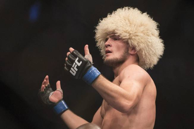 Russia's Khabib Nurmagomedov celebrates after beating Pat Healy in their UFC 165 bout in Toronto on Saturday Sept. 21, 2013. (AP Photo/The Canadian Press, Chris Young)