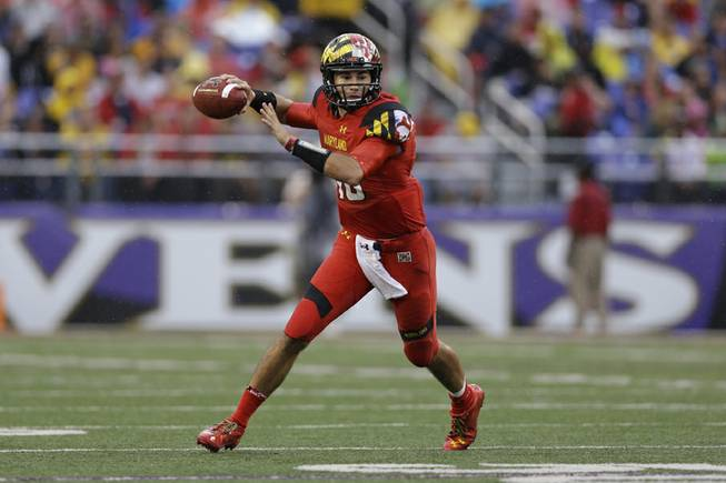 Maryland quarterback C.J. Brown looks for a receiver in the first half of an NCAA college football game against West Virginia in Baltimore, Saturday, Sept. 21, 2013.