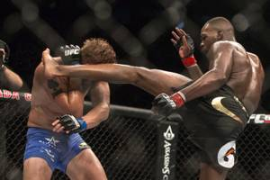 American Jon Jones (right) lands a kick on Sweden's Alexander Gustafsson during their World Light Heavyweight Championship bout during UFC 165 in Toronto on Saturday Sept. 21, 2013. (AP Photo/The Canadian Press, Chris Young)