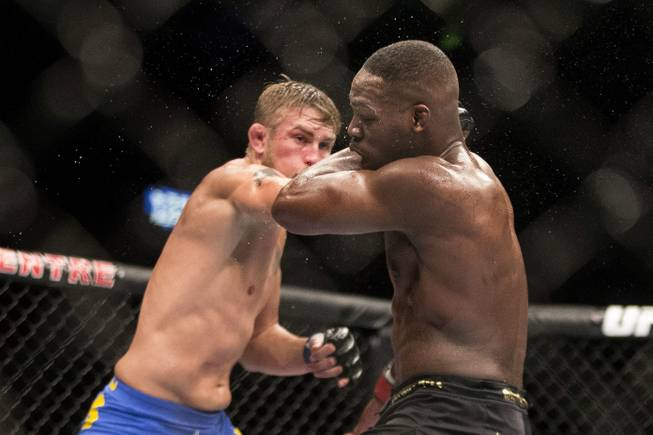 Sweden's Alexander Gustafsson (left) lands a blow on American Jon Jones during their World Light Heavyweight Championship bout during UFC 165 in Toronto on Saturday Sept. 21, 2013. (AP Photo/The Canadian Press, Chris Young)