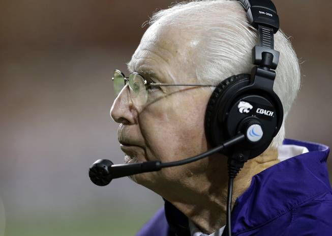 Kansas State coach Bill Snyder watches his team during the first half of an NCAA college football game against Texas, Saturday,  Sept. 21, 2013, in Austin, Texas.