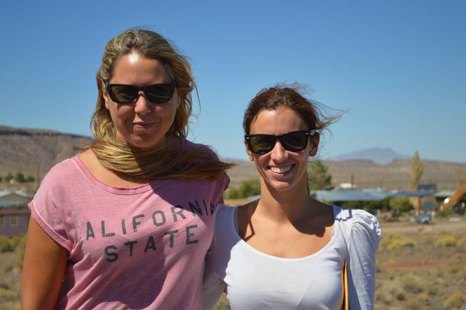 Miriam Nerecan, left, and Alba Amoros take a break while on assignment in Goldfield on Sept. 18, 2013. The pair, who now report on news in the region, moved from Spain to Tonopah when their husbands took jobs working on a solar power plant being built in the Big Smoky Valley west of town.
