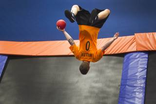 Ryan Miller of Plainfield, Ind. does a flip during the 2013 Ultimate Dodgeball Championship at the SkyZone Las Vegas Trampoline Park, 7440 Dean Martin Dr., Sunday, Sept. 22, 2013. Teams from the U.S. and Canada competed for their share of $50,000 of prize money. The event was filmed for later broadcast on the Fox Sports Network.