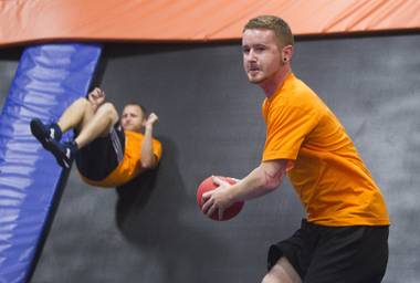 Ryan Miller, right, of Plainfield, Ind., practices before a match during the 2013 Ultimate Dodgeball Championship at SkyZone Las Vegas Trampoline Park, 7440 Dean Martin Drive, on Sunday, Sept. 22, 2013. Teams from the U.S. and Canada competed for a share of $50,000 in prize money. The event was filmed for later broadcast on Fox Sports Network.