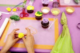 A student prepares a flower made from fondant during a class taught in Spanish on cupcake decorating at Sweet House in Las Vegas on Monday, September 223, 2013.
