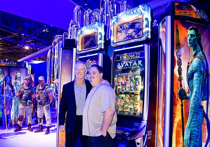 "Actor Stephen Lang, left, and movie producer Jon Landau pose by ""Avatar""-themed video slot machines by International Game Technology (IGT) during the G2E convention at the Sands Expo Center Tuesday, Sept. 24, 2013. Landau was producer of the 2009 Avatar movie and Lang played Colonel Miles Quaritch in the film."
