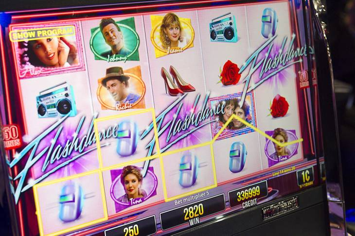 A screen from a Flashdance video slot machine by Aristocrat is shown during the G2E convention at the Sands Expo Center Tuesday, Sept. 24, 2013.