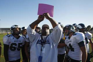Rancho football coach Tyrone Armstrong calls a play during practice Tuesday, Sept. 24, 2013.