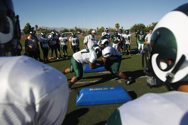 Rancho football players take part in a drill during practice Tuesday, Sept. 24, 2013.