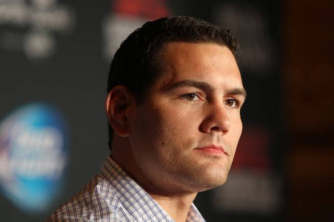 Chris Weidman listens to a question during a news conference to promote his December fight against Anderson Silva at UFC 168 Tuesday, Sept. 24, 2013.
